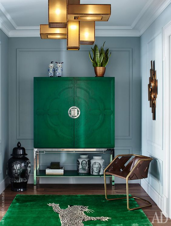 7 emerald green spaces that scream elegance daily dream decor - Bar furniture for living room ...