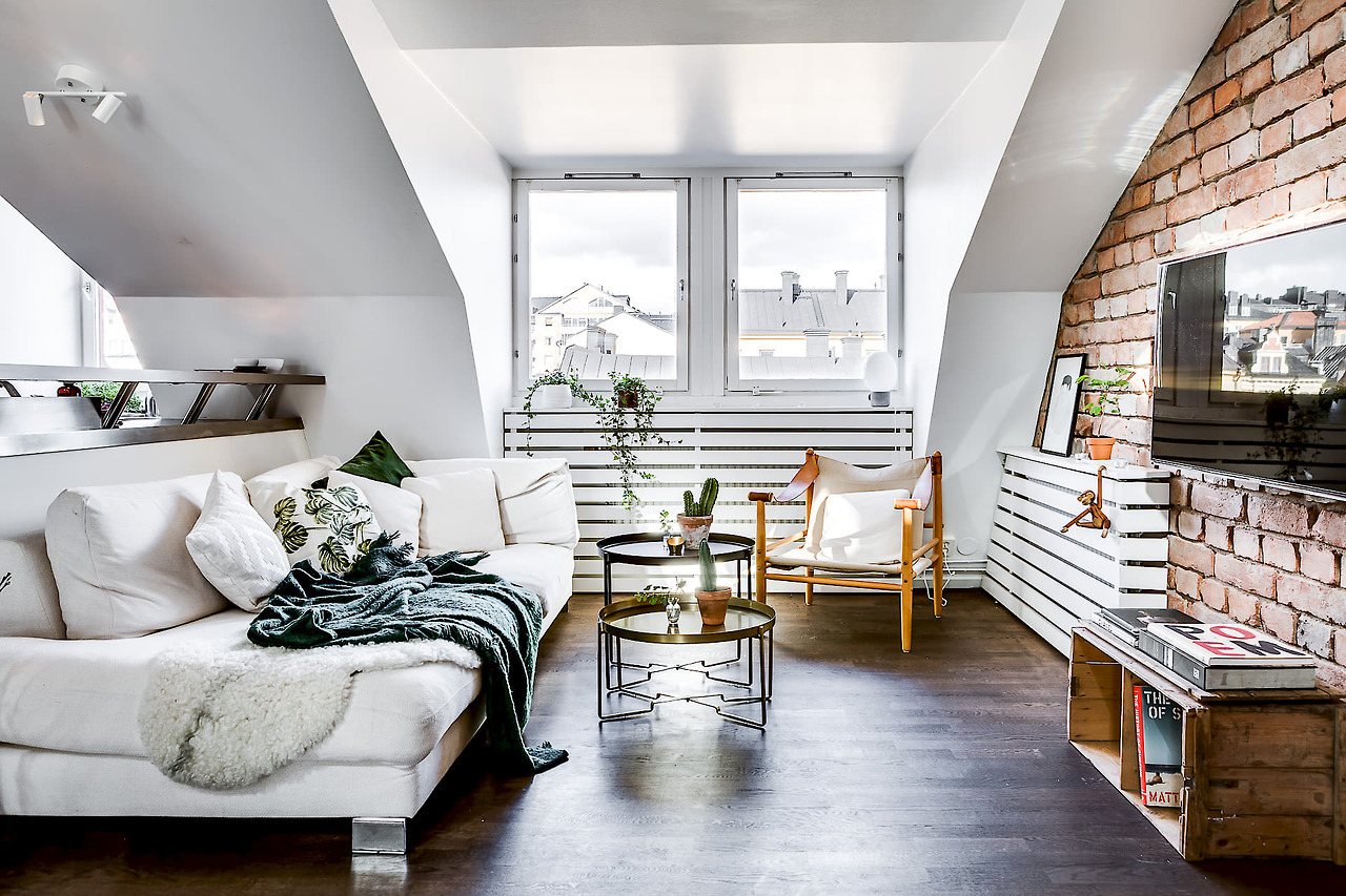 A gorgeous attic apartment with a brick wall - Daily Dream Decor