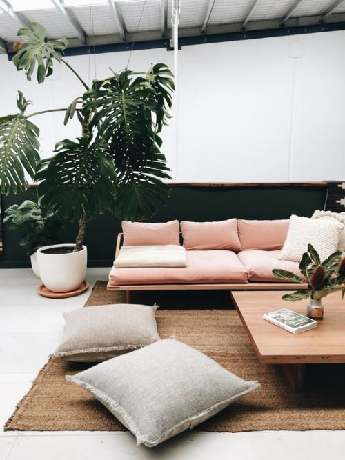 muted pink linen and black with tropical plants