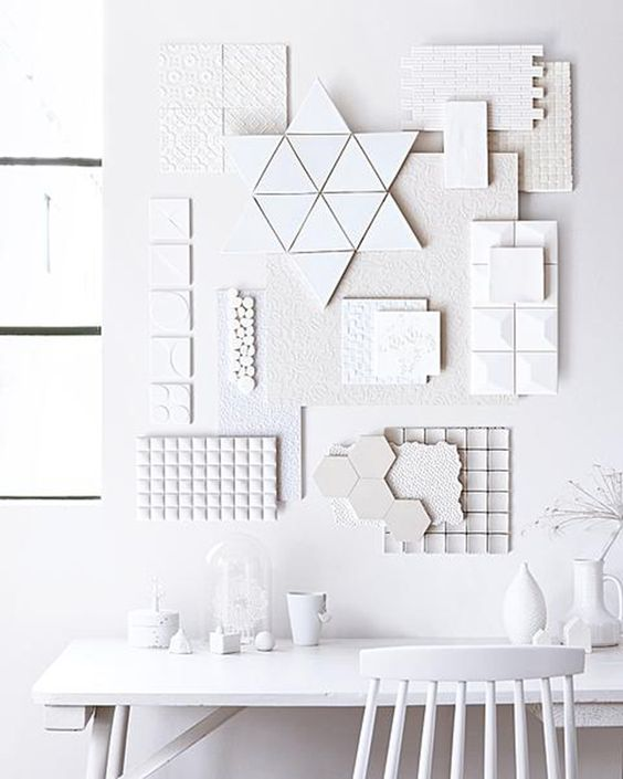 Use abstract and geometric elements and match them whit a minimal desk and  a fancy or retro chair, in white of course!