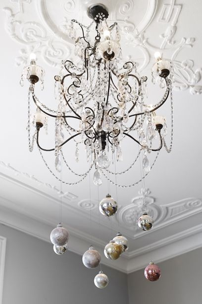 8 dreamy ways to add stylish christmas ornaments in your home let the globes swing from the chandelier and add this dreamy scenario on top of a dining table pick neutral ornaments and some made of glass and bring mozeypictures Image collections