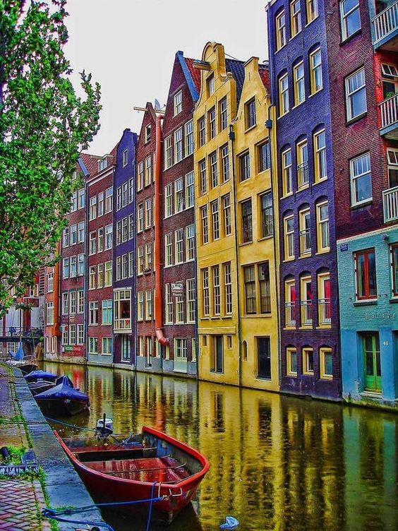 colorful houses amsterdam facades