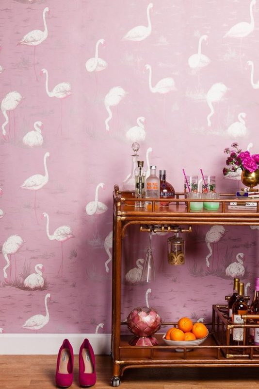flamingo wall paper next to a bar