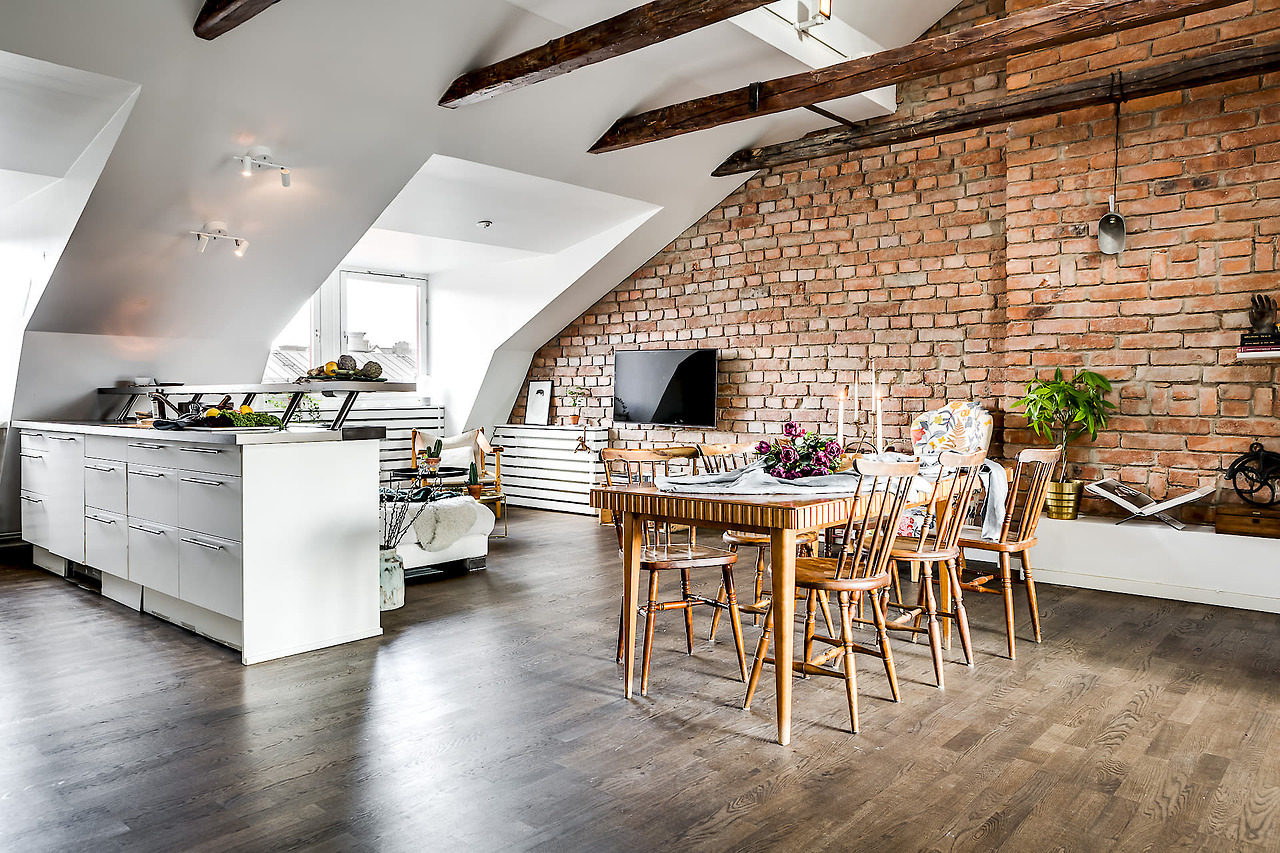 A gorgeous attic apartment with a brick wall